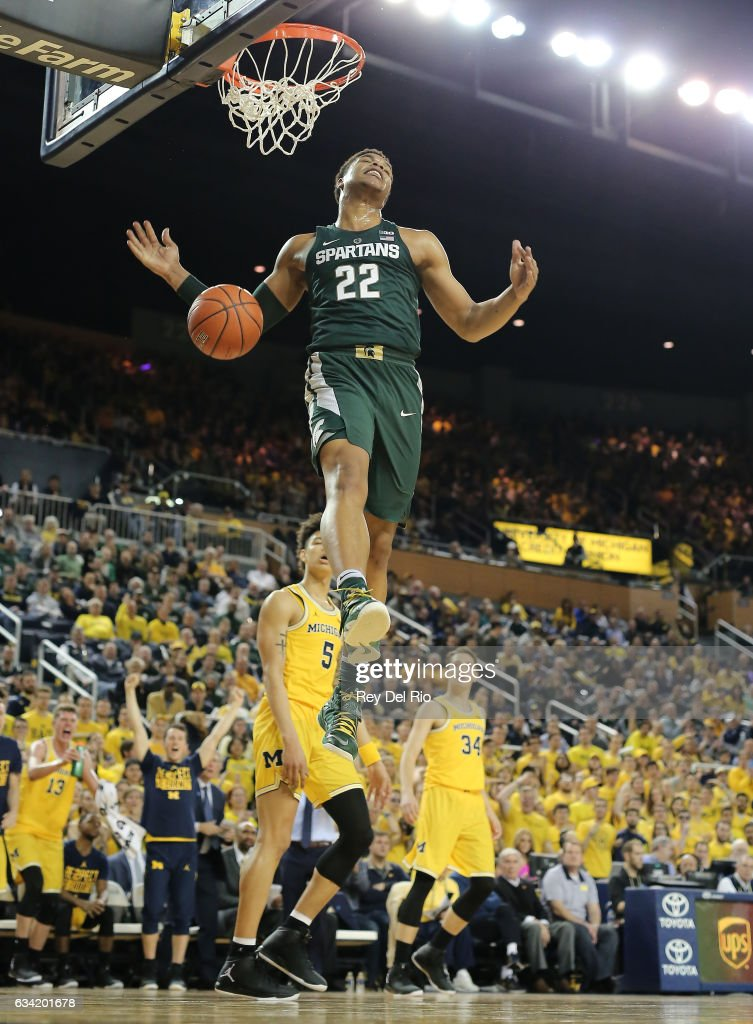 Miles Bridges #22 of the Michigan State Spartans dunk after the shot clock expires in the first half against the Michigan Wolverines at Crisler Arena on February 7, 2017 in Ann Arbor, Michigan.