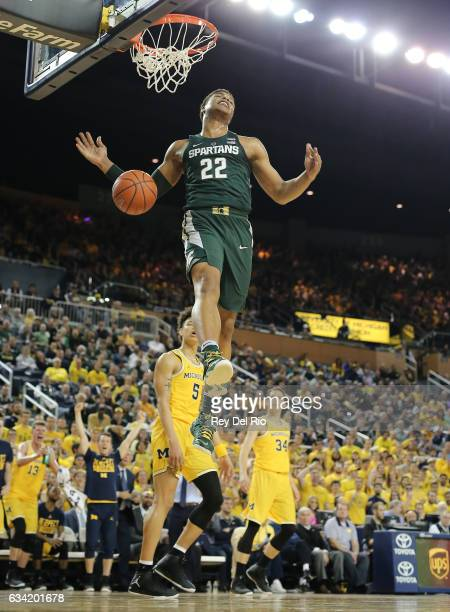 Miles Bridges of the Michigan State Spartans dunk after the shot clock expires in the first half against the Michigan Wolverines at Crisler Arena on...