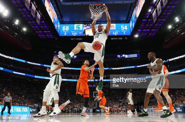 Miles Bridges of the Michigan State Spartans dunks the ball during the second half against the Bucknell Bison in the first round of the 2018 NCAA...