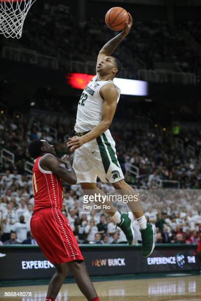 Miles Bridges of the Michigan State Spartans goes up for a dunk against TyQuone Greer of the Ferris State Bulldogs during the exhibition game at...