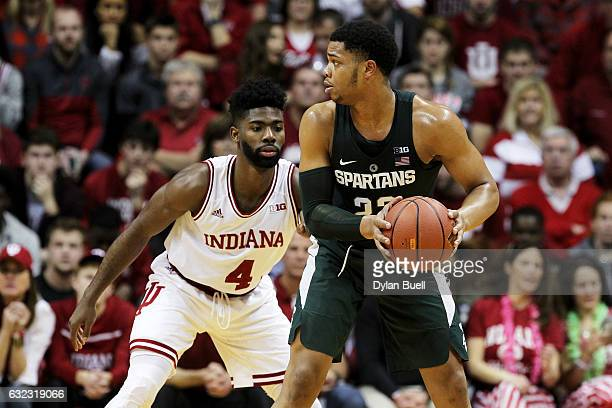 Miles Bridges of the Michigan State Spartans handles the ball while being guarded by Robert Johnson of the Indiana Hoosiers in the first half at...
