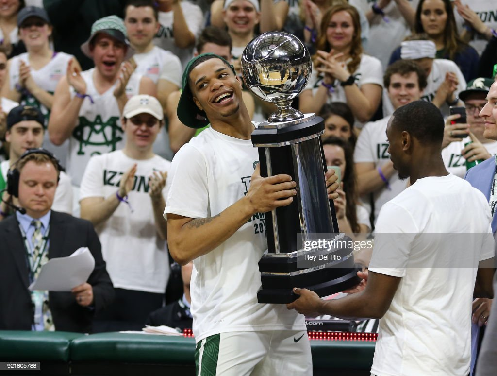 Miles Bridges #22 of the Michigan State Spartans holds the Big Ten trophy after the Spartan defeated the Illinois Fighting Illini at Breslin Center on February 20, 2018 in East Lansing, Michigan.