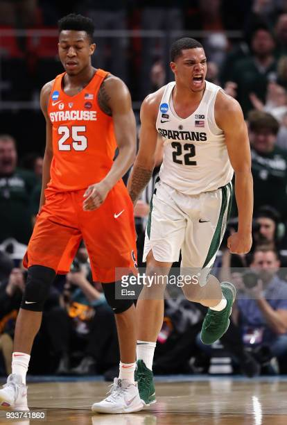 Miles Bridges of the Michigan State Spartans reacts after dunking the ball during the second half against the Syracuse Orange in the second round of...