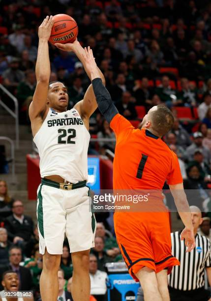 Miles Bridges of the Michigan State Spartans shoots over G Kimbal MacKenzie of the Bucknell Bison during the NCAA Division I Men's Basketball...