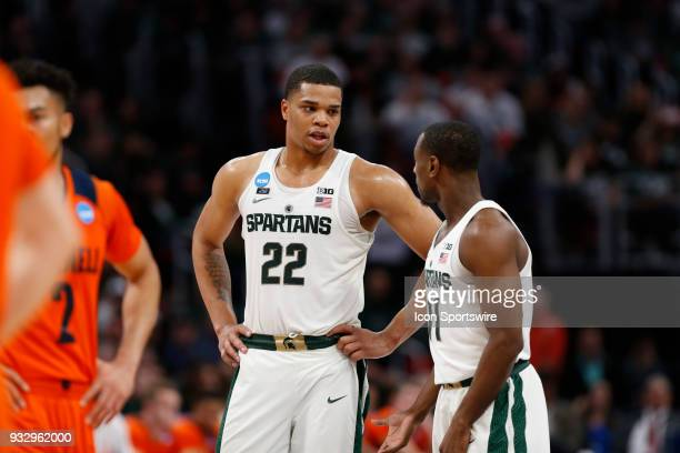 Miles Bridges of the Michigan State Spartans talks with G Lourawls Nairn of the Michigan State Spartans during the NCAA Division I Men's Basketball...