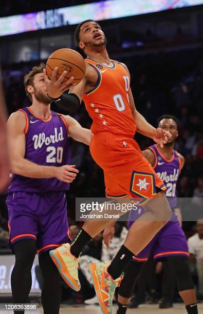 Miles Bridges of the USA puts up a shot past Nicolo Melli of the World at the United Center on February 14 2020 in Chicago Illinois The USA defeated...