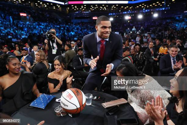 Miles Bridges reacts after being selected twelfth by the LA Clippers on June 21 2018 at Barclays Center during the 2018 NBA Draft in Brooklyn New...