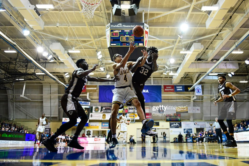 Miles Brookins #4 of the La Salle Explorers and Amadi Ikpeze #32 of the St. Bonaventure Bonnies vie for the ball during the second half at Tom Gola Arena on February 13, 2018 in Philadelphia, Pennsylvania. St. Bonaventure defeated La Salle 79-68.