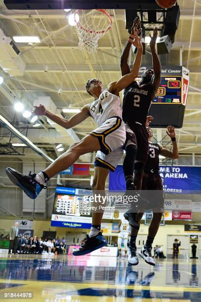 Miles Brookins of the La Salle Explorers and Matt Mobley of the St Bonaventure Bonnies vie for the ball during the second half at Tom Gola Arena on...