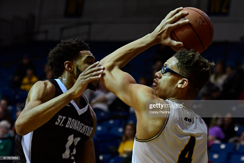 Miles Brookins #4 of the La Salle Explorers looks to pass against Courtney Stockard #11 of the St. Bonaventure Bonnies during the second half at Tom Gola Arena on February 13, 2018 in Philadelphia, Pennsylvania. St. Bonaventure defeated La Salle 79-68.