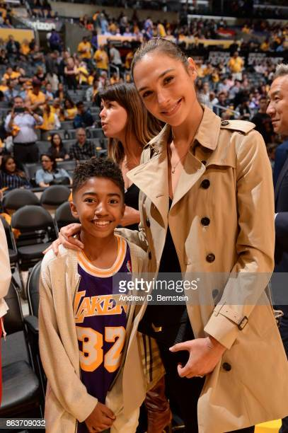 Miles Brown and Gal Gadot pose for a photo before the game between the Los Angeles Lakers and LA Clippers on October 19 2017 at STAPLES Center in Los...