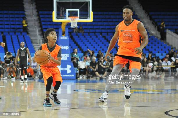 Miles Brown and Rashad Jennings participate in Monster Energy Outbreak $50K Charity Challenge celebrity basketball game at UCLA on July 17 2018 in...