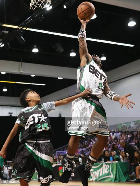 Miles Brown and YFN Lucci play basketball at the Celebrity Basketball Game Sponsored By Sprite during the 2018 BET Experience at Los Angeles...