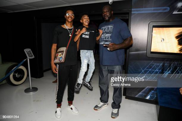 Miles Brown poses at Shareef O'Neal's 18th birthday party with Shaquille O'Neal and Shareef O'Neal at West Coast Customs on January 13 2018 in...