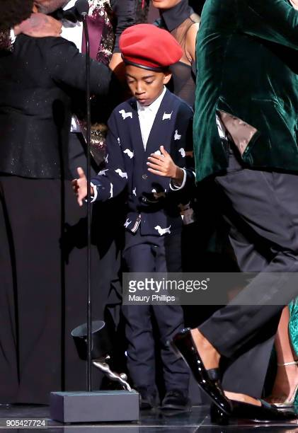 Miles Brown reacts when the trophy for the Outstanding Comedy Series award for 'blackish' falls onstage during the 49th NAACP Image Awards at...