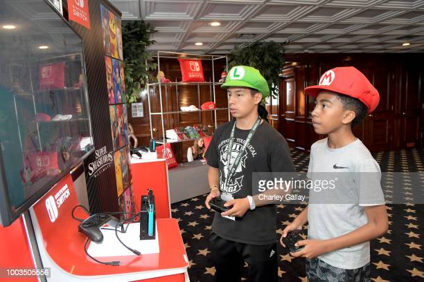 Miles Brown tests his skills on Super Smash Bros Ultimate for Nintendo Switch at the Variety Studio at ComicCon 2018 on July 21 2018 in San Diego...