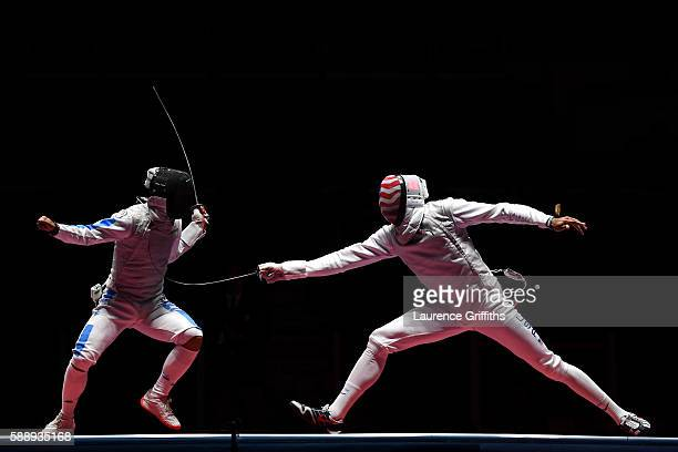 Miles ChamleyWatson of the United States competes against Andrea Baldini of Italy during the Men's Foil Team Bronze Medal Match bout on Day 7 of the...
