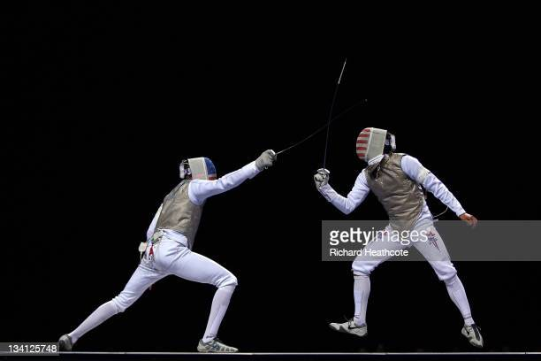 Miles ChamleyWatson of the USA in action against Gerek Meinhardt of the USA in the final of the Men's Foil Individual at the Fencing Invitational...