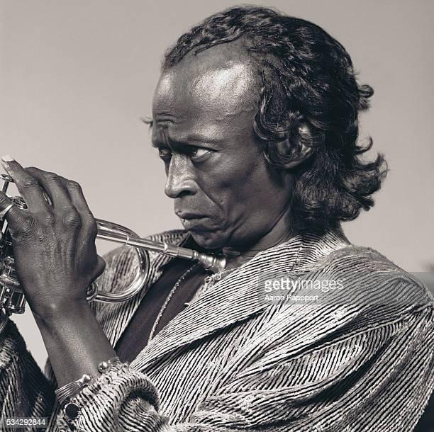 Miles Davis holding a trumpet