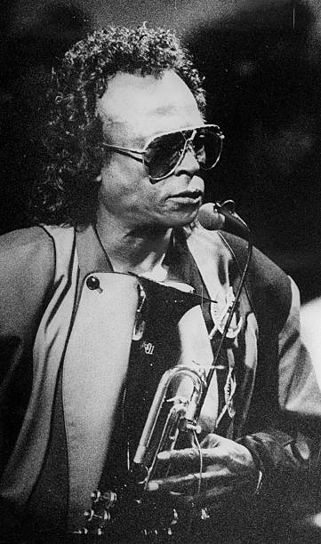 Miles Davis performing in a club.