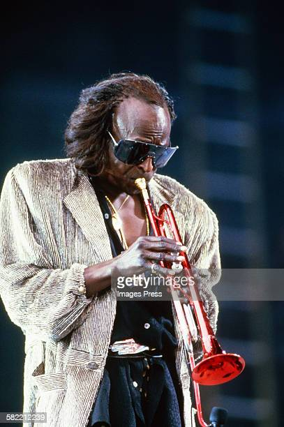 Miles Davis performs at the Amnesty International Concert at Giants Stadium circa 1986 in East Rutherford New Jersey