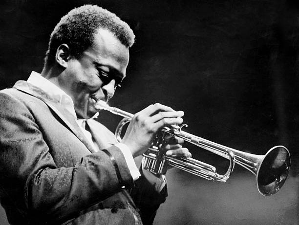 Miles Davis performs at the Newport Jazz Festival.