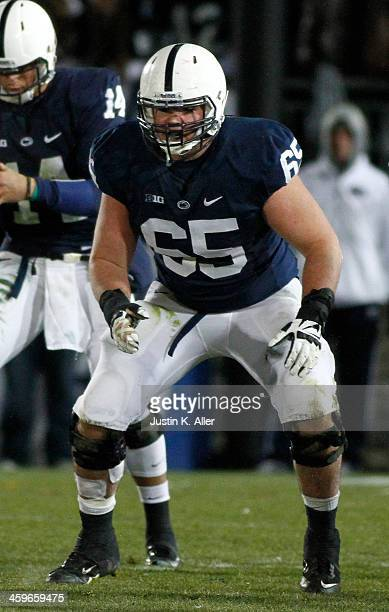Miles Dieffenbach of the Penn State Nittany Lions blocks against the Nebraska Cornhuskers during the game on November 23 2013 at Beaver Stadium in...