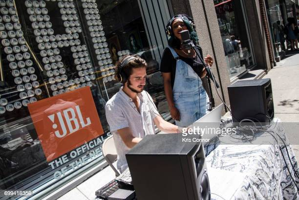 Miles Francis and performer RKHTY perform during the street studio as part of Make Music Day New York on June 21 2017 in New York City