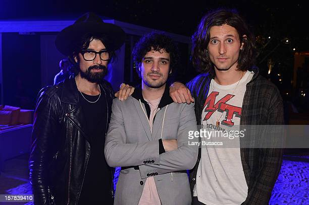 DJ Miles Hendrix with musicians Nick Valensi and Fabrizio Moretti of The Strokes attend the Carrera Cocktail Party hosted by AD Oasis at The Raleigh...