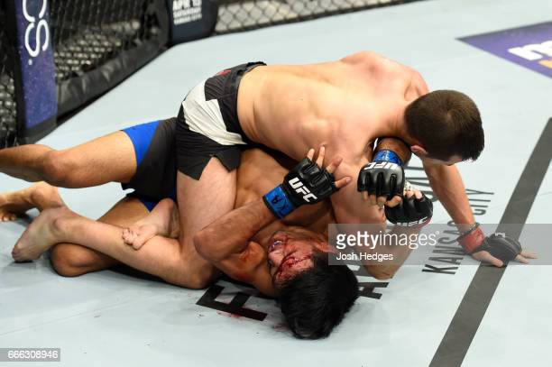 Miles Jury takes down Mike De La Torre in their featherweight bout during the UFC 210 event at KeyBank Center on April 8 2017 in Buffalo New York