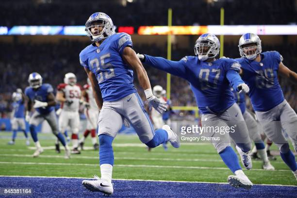 Miles Killebrew of the Detroit Lions celebrates a fourth quarter touchdown with Armonty Bryant after he intercepts a pass while playing the Arizona...