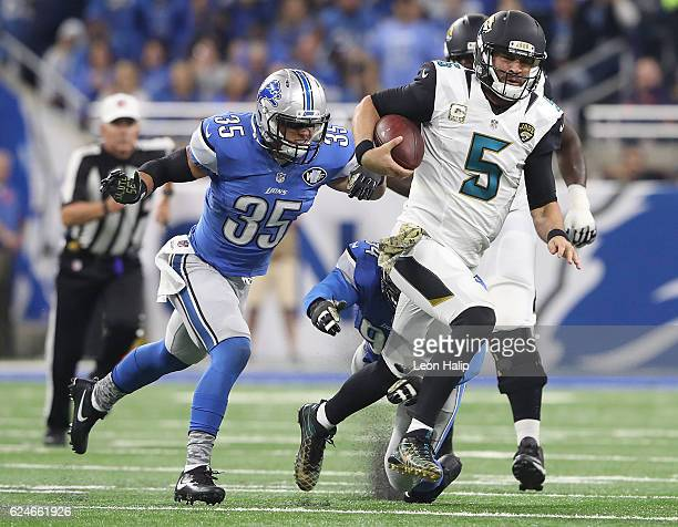 Miles Killebrew of the Detroit Lions chases down quarterback Blake Bortles of the Jacksonville Jaguars during first half action at Ford Field on...
