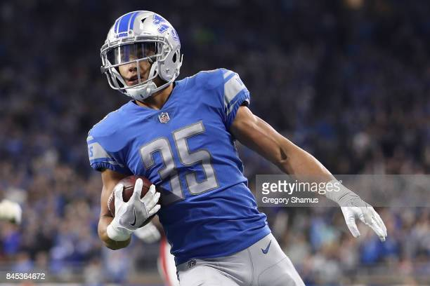Miles Killebrew of the Detroit Lions runs the ball in for a touchdown in the second half against the Arizona Cardinals at Ford Field on September 10,...