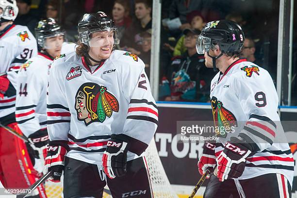 Miles Koules and Chase De Leo of Portland Winterhawks celebrate a third period goal against the Kelowna Rockets on November 21 2014 at Prospera Place...