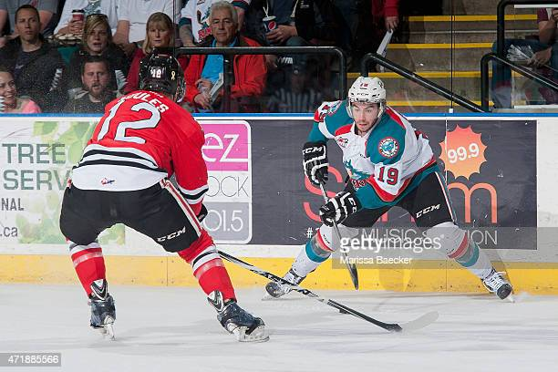 Miles Koules of Portland Winterhawks checks Dillon Dube of Kelowna Rockets during first period of game 5 of the Western Conference Final on May 1...