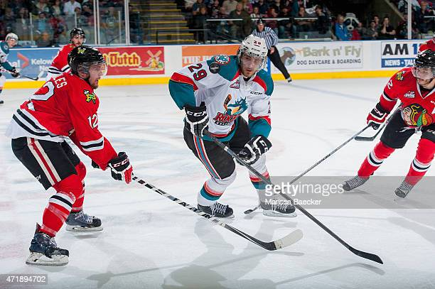 Miles Koules of Portland Winterhawks checks Leon Draisaitl of Kelowna Rockets during overtime of game 5 of the Western Conference Final on May 1 2015...