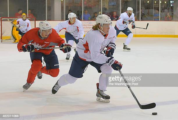 Miles Koules right heads down ice with Andre Burakovsky left giving chase during the intrasquad scrimmage at the Washington Capitals development camp...