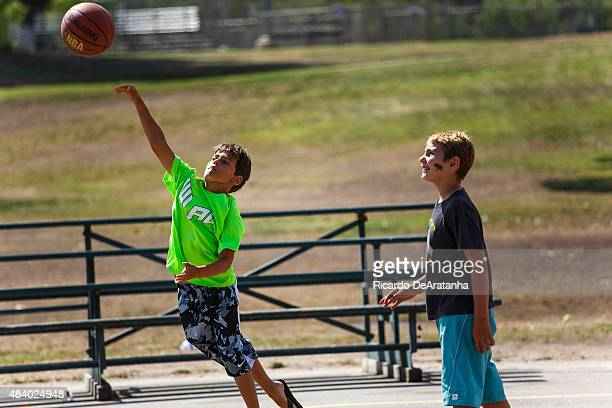Miles La TourretteGhez shoots the basketball while his friend Brayden Houston looks on at Cheviot Hills Community Center August 13 2015 in West Los...