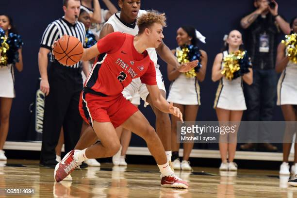 Miles Latimer of the Stony Brook Seawolves dribbles the ball during a college basketball game against the George Washington Colonials at the Smith...