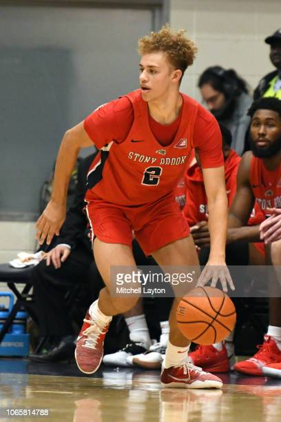 Miles Latimer of the Stony Brook Seawolves looks on during a college basketball game against the George Washington Colonials at the Smith Center on...