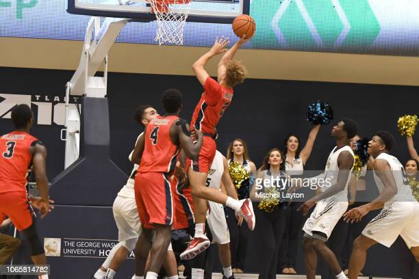 Miles Latimer of the Stony Brook Seawolves takes a shot during a college basketball game against the George Washington Colonials at the Smith Center...