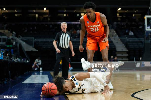 Miles McBride of the West Virginia Mountaineers dives for a ball in the second half of their second round game against the Syracuse Orange in the...