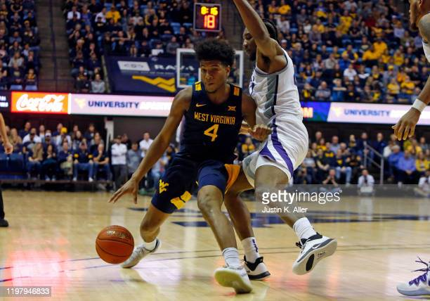 Miles McBride of the West Virginia Mountaineers drives against the Kansas State Wildcats at the WVU Coliseum on February 1 2020 in Morgantown West...