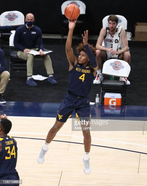 Miles McBride of the West Virginia Mountaineers shoots the ball against the Gonzaga Bulldogs during the Jimmy V Classic at Bankers Life Fieldhouse on...