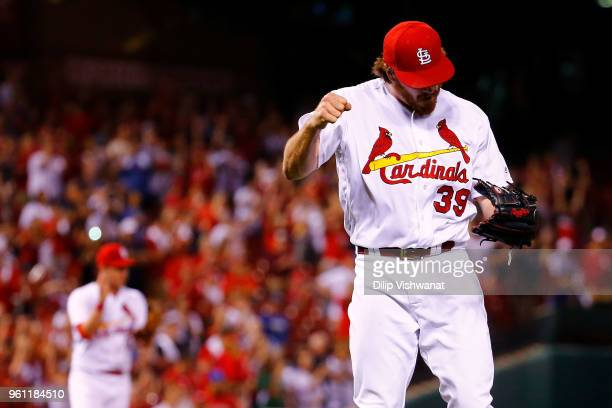 Miles Mikolas of the St Louis Cardinals celebrates after throwing a complete game against the Kansas City Royals at Busch Stadium on May 21 2018 in...