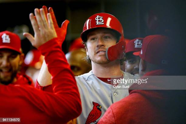 Miles Mikolas of the St Louis Cardinals celebrates with teammates after hitting a home run in the fifth inning against the Milwaukee Brewers at...