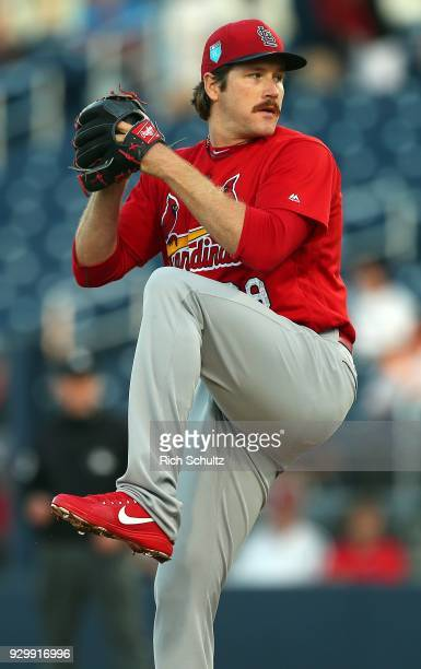 Miles Mikolas of the St Louis Cardinals delivers a pitch against the Houston Astros during the first inning of a spring training game at FITTEAM Ball...