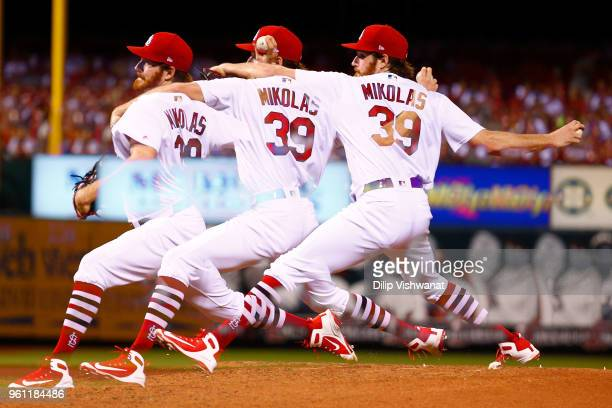 Miles Mikolas of the St Louis Cardinals delivers a pitch against the Kansas City Royals in the seventh inning at Busch Stadium on May 21 2018 in St...