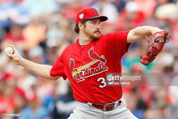 Miles Mikolas of the St Louis Cardinals delivers a pitch in the third inning against the Atlanta Braves during the Grapefruit League spring training...
