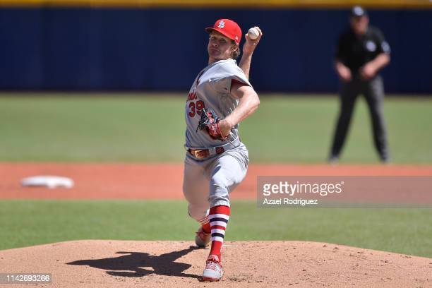 Miles Mikolas of the St Louis Cardinals pitches in the first inning of the second game of the Mexico Series between the Cincinnati Reds and the St...